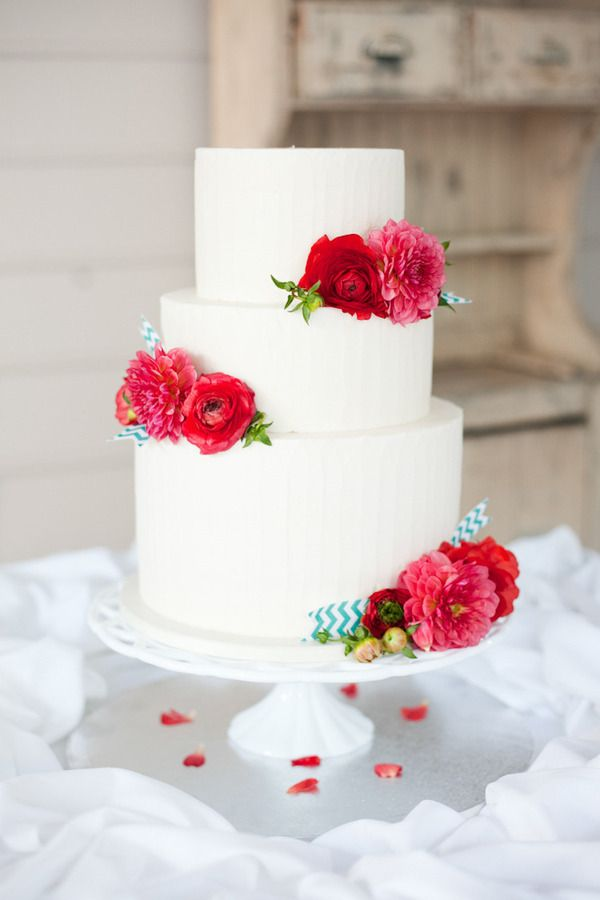 White Wedding Cake with Bright Colored Flowers